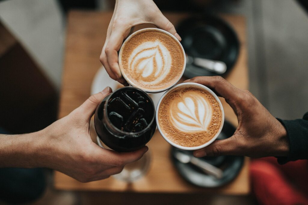 People Cheers with coffee