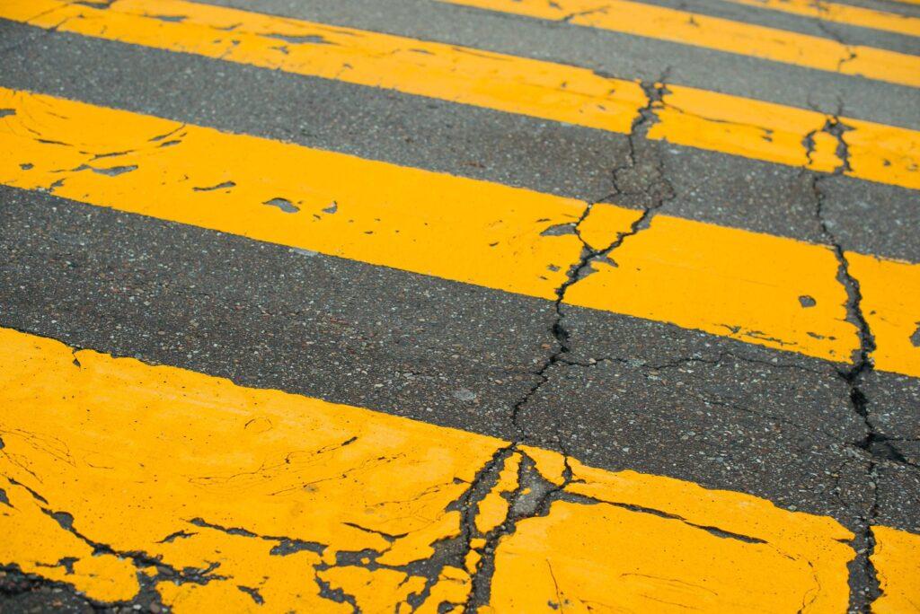 Yellow Crossing Lines in Urban Street